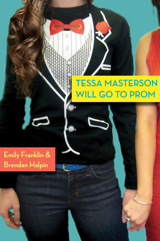 A girl wearing a t-shirt of a tux and jeans holding hands with a girl