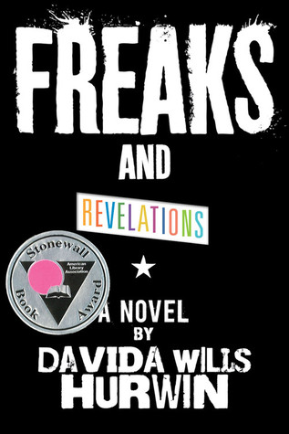 Freaks is painted on and Revelations is written in rainbow font