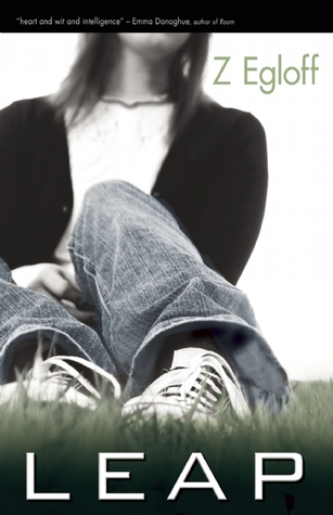 A desaturated picture of a girl sitting the grass