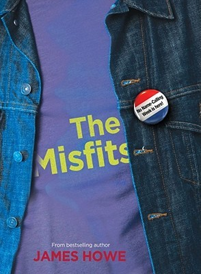 A close up of a blue t shirt and jean jacket with a button colored red white and blue
