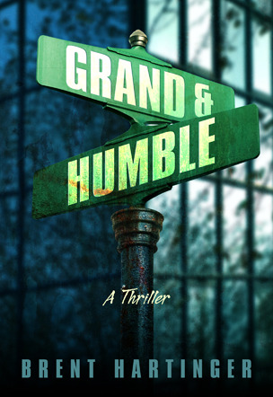 A green street crossing sign says Grand & Humble