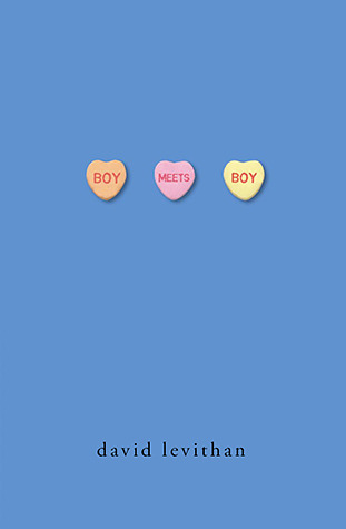 Three candy hearts sit next to each other on a blue background