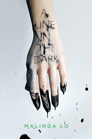 A hand and wrist pointing down and dripping black ink or paint down; the title is written on the arm and washing away like watercolor