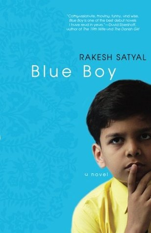 A small Indian child looks up, his hand to his chin, in front of a blue background