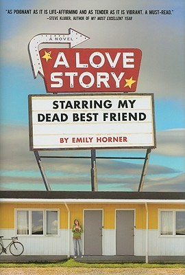 An old fashioned marquee reading A Love Story Starring My Dead Best Friend is over a yellow motel with a girl standing in front of it