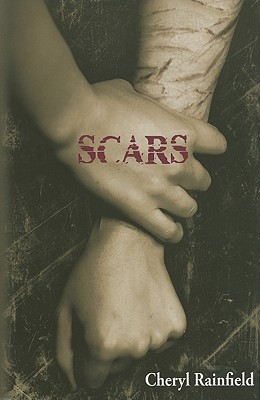 A hand clenches onto an arm covered in scars