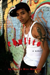 A brown boy in a white tank and with a tribal tattoo leans against a grafitti wall