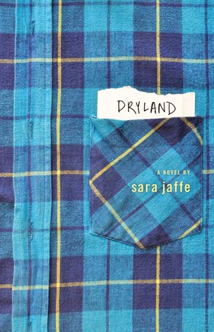 A flannel shirt and pocket, with the title on a piece of paper in the pocket.