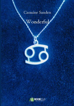 A blue cover with a necklace that has a charm representing the astrological sign Cancer.