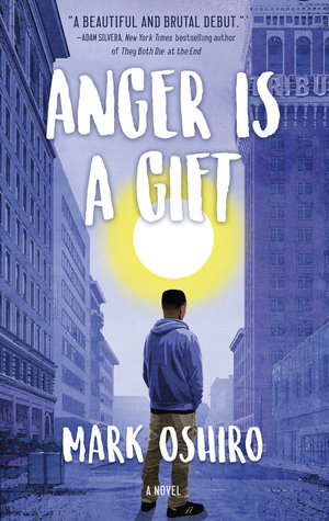 Book cover showing boy in hoodie between tall office buildings.