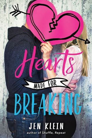 Book cover showing couple embracing holding a paper broken heart over their heads.