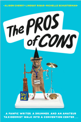 Book cover showing a mouse in witch's costume with a cymbal and con badge.