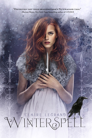 A redhaired girl in white and grey stares at the camera holding a knife in front of a white iron gate