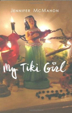 A bobble tiki girl on a desk with fairy lights around it