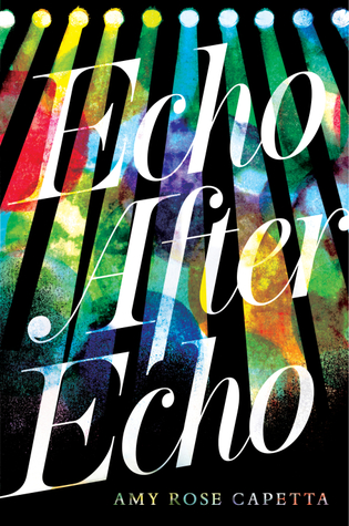 Multicolored spotlights shine abstract colors down over the title in white letters