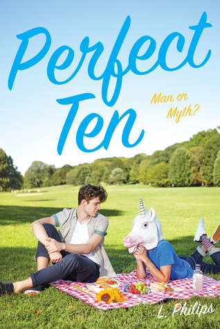 A picnic scene with a boy and a person's body with a unicorn head