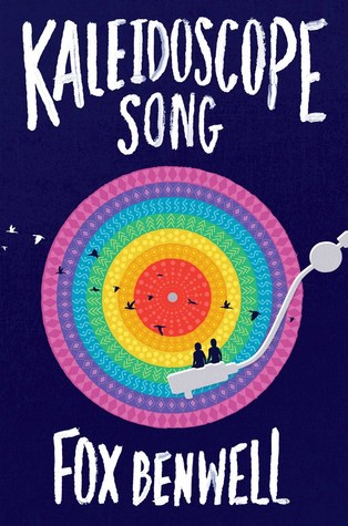 A record player with pastel rainbow colors and silhouettes of two figures sitting on the arm and a line of black birds flying through it