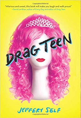 A pink curly wig wearing a sparkly silver tiara rests atop a wig stand that has bright red lips.