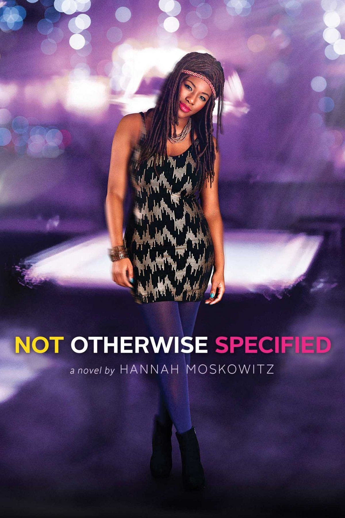 An African American girl wearing a short striped dress and purple tights and a headband stands with one leg crossed over the other and her head titled to the side.  The background is a blurry purple with blurry lights.