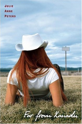 A girl in a white hat sits with her back to the camera, looking over a dry field