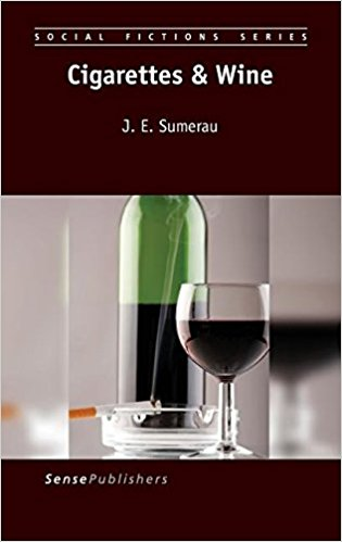a photo of a cigarette in a an ash tray and a bottle and a glass of red wine