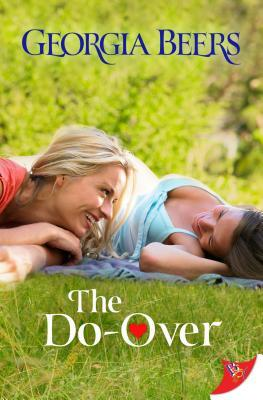 Book cover showing two girls lying in the grass smiling at each other.
