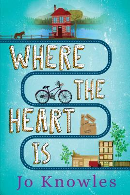 Book cover showing a bicycle on a path from a lake house to a city block.